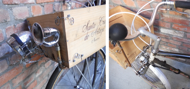 The old horn attached to the wine box is plumbed in from the handle bar. It give out a mighty honk. Wire scroll work gives the box strength and flair. The beautiful old light casing hides a modern light mechanism.